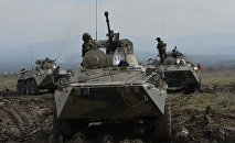 A file photo showing BTR-82A armored vehicles during the battalion tactical field firing exercise
