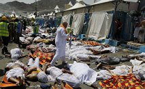 Muslim pilgrim walks through the site where dead bodies are gathered after a stampede during the annual hajj pilgrimage, in Mina, Saudi Arabia. (File)