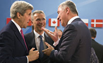Montenegro's Prime Minister Milo Dukanovic, right, speaks with U.S. Secretary of State John Kerry, left, and NATO Secretary General Jens Stoltenberg, center, during a meeting of the North Atlantic Council at NATO headquarters in Brussels on Thursday, May 19, 2016