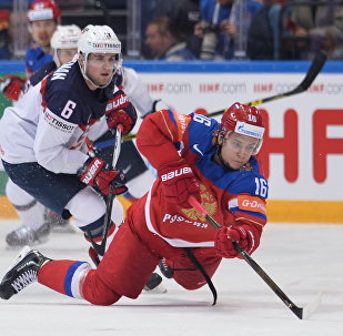 Russia's Sergei Plotnikov, right, and United States' Chris Wideman during the 2016 IIHF World Championship bronze medal match between the Russian and US national teams