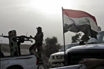 Iraqi government forces and affiliated militias prepare for combat with Daesh outside of Fallujah.