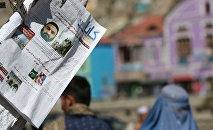 Newspapers hang for sale at a stand carrying headlines about the former leader of the Afghan Taliban, Mullah Akhtar Mansoor, who was killed in a U.S. drone strike last week, in Kabul, Afghanistan, Wednesday, May 25, 2016