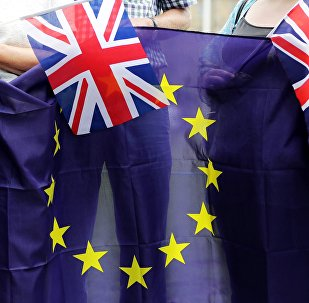 People hold Union Flags and the EU flag at a kiss chain event organised by pro-Europe 'remain' campaigners seeking to avoid a Brexit in the EU referendum in Parliament Square in front of the Houses of Parliament in central London on June 19, 2016.