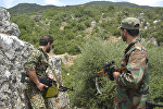 Syrian pro-government forces patrol an area in Hama province. (File)