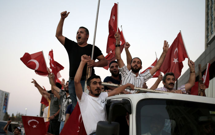 Supporters of Turkish President Tayyip Erdogan shout slogans on the back of a truck during a pro-government demonstration on Taksim square in Istanbul, Turkey, July 16, 2016.