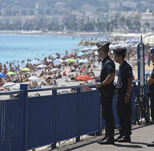 French police officers patrol on the famed Promenade des Anglais in Nice, southern France, three days after a truck mowed through revelers, Sunday, July 17, 2016