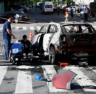Investigators at the site where journalist Pavel Sheremet was killed by a car bomb in central Kiev, Ukraine, July 20, 2016