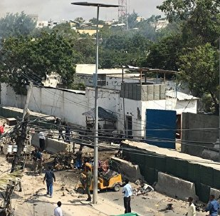 Two loud explosions with ensuing heard near the Criminal Investigation Department headquarters in Somalia's capital Mogadishu, witness reports