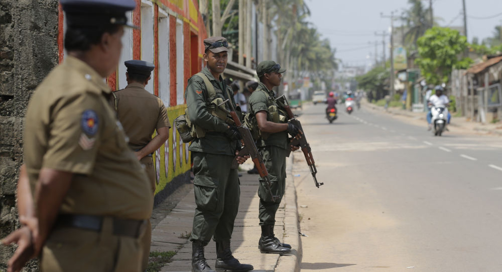 Sri Lankan army soldiers and police stand guard on a road in a Muslim neighborhood following overnight clashes in Poruthota, a village in Negombo, about 35 kilometers North of Colombo, Sri Lanka, Monday, May 6, 2019