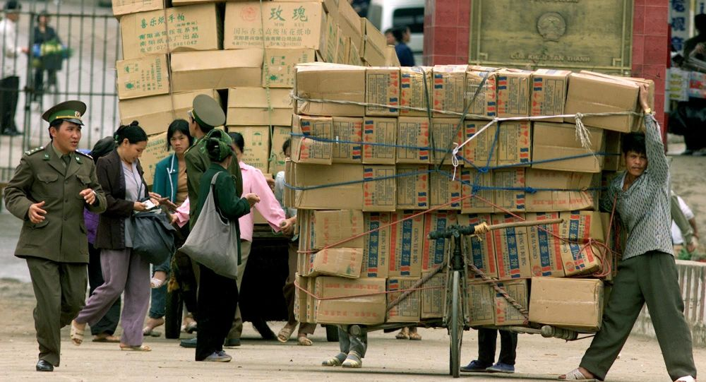 A Vietnamese border patrol guard checks Chinese goods arriving at the Tan Thanh border checkpoint with China in Lang Son, 165 kilometers (100 miles) northeast of Hanoi, on Monday, Feb. 25, 2002