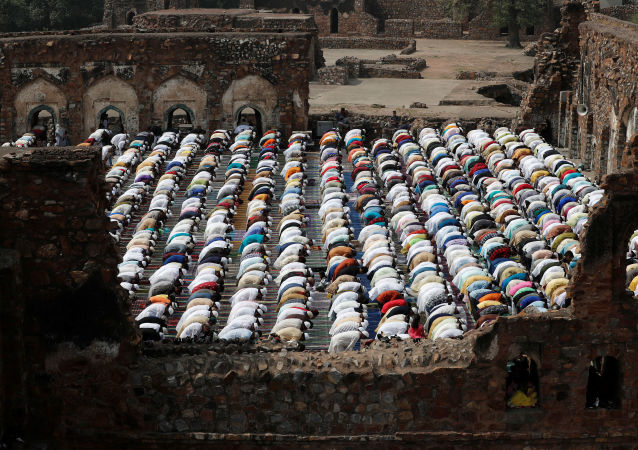 Muslims offer Eid al-Fitr prayers at the ruins of Feroz Shah Kotla mosque in New Delhi, India June 5, 2019