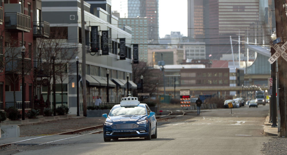 In this Dec. 18, 2018, photo one of the test vehicles from Argo AI, Ford's autonomous vehicle unit, navigates through the strip district near the company offices in Pittsburgh