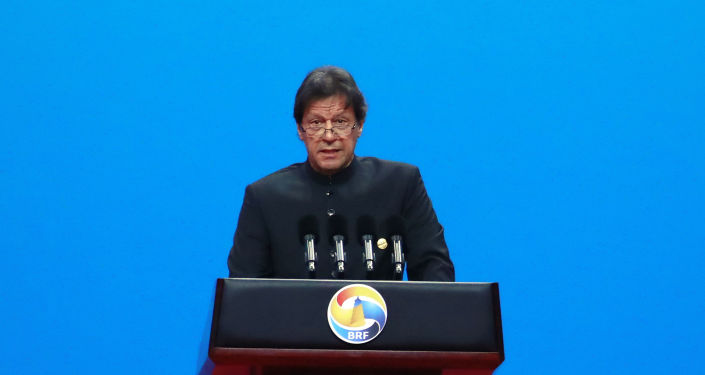 Pakistani Prime Minister Imran Khan delivers his speech for the opening ceremony of the second Belt and Road Forum for International Cooperation (BRF) on Friday, April 26, 2019, in Beijing. (How Hwee Young/Pool Photo via AP)