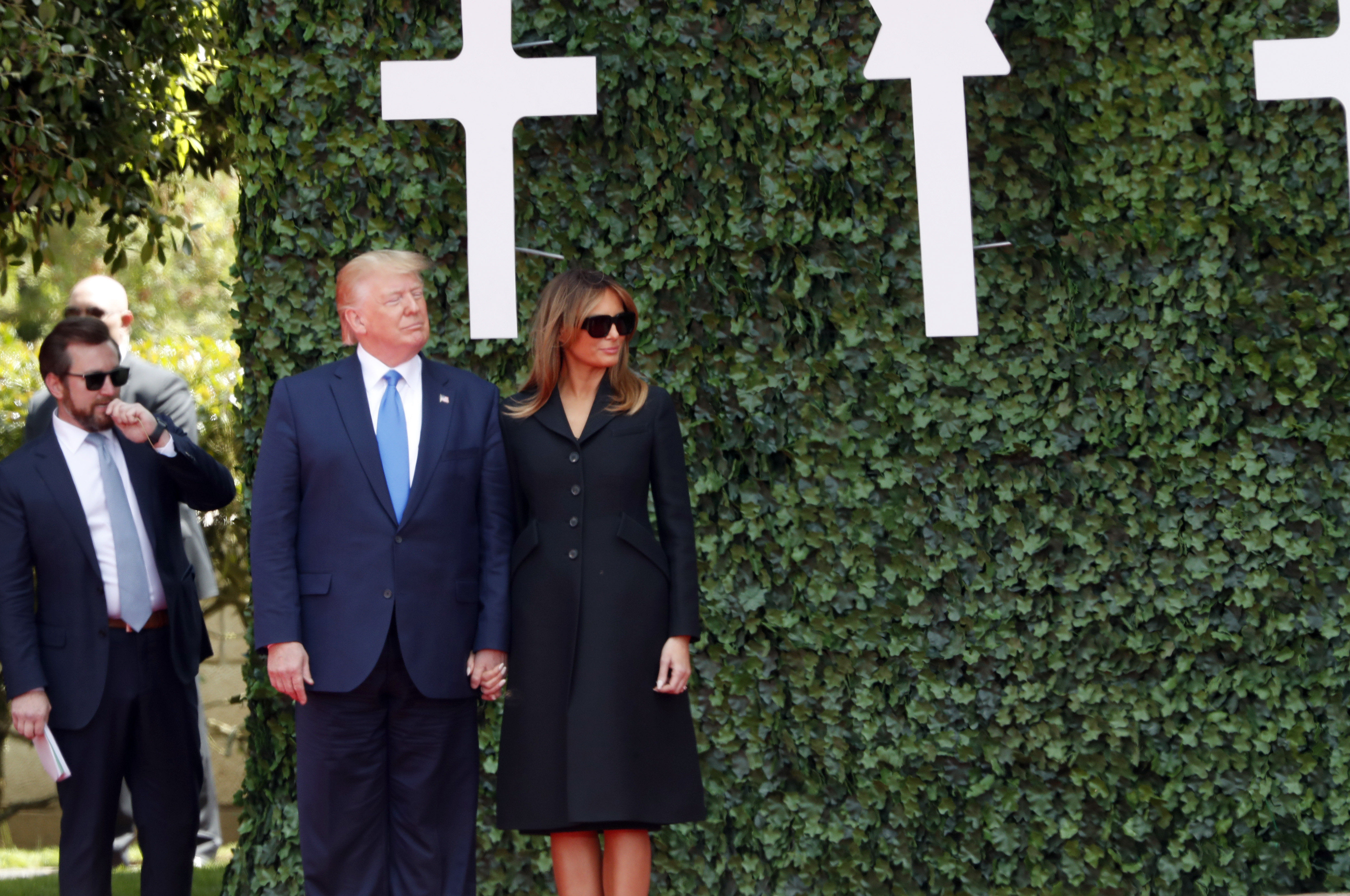 U.S. President Donald Trump and first lady Melania Trump arrive for a ceremony to mark the 75th anniversary of D-Day at the Normandy American Cemetery in Colleville-sur-Mer, Normandy, France, Thursday, June 6, 2019. World leaders are gathered Thursday in France to mark the 75th anniversary of the D-Day landings. (AP Photo/Thibault Camus)