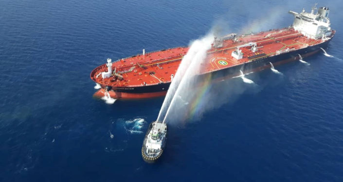 An Iranian navy boat tries to stop the fire of an oil tanker after it was attacked in the Gulf of Oman, June 13, 2019
