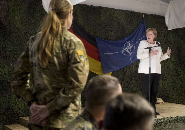 German Chancellor Angela Merkel delivers her speech during a meeting with German Bundeswehr soldiers of the NATO enhanced forward presence battalion at the Rukla military base