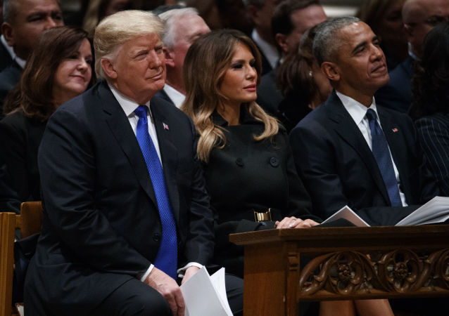 President Donald Trump, first lady Melania Trump, and former President Barack Obama watch during the State Funeral for former President George H.W. Bush at the National Cathedral, Wednesday, Dec. 5, 2018, in Washington. (AP Photo/Evan Vucci)
