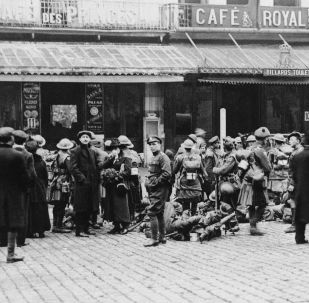 Canadian army troops gather in the center of Mons, Belgium, which was liberated in November 1918