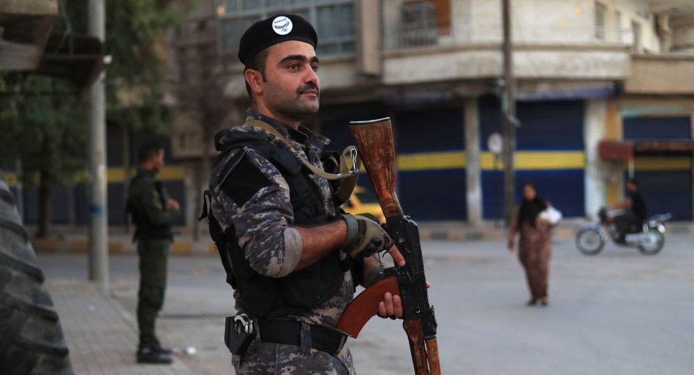 Members of the Kurdish Internal Security Police Force of Asayish keep watch during a security alert after clashes with regime forces in Qamishli, northeastern Syria, on 8 September 2018