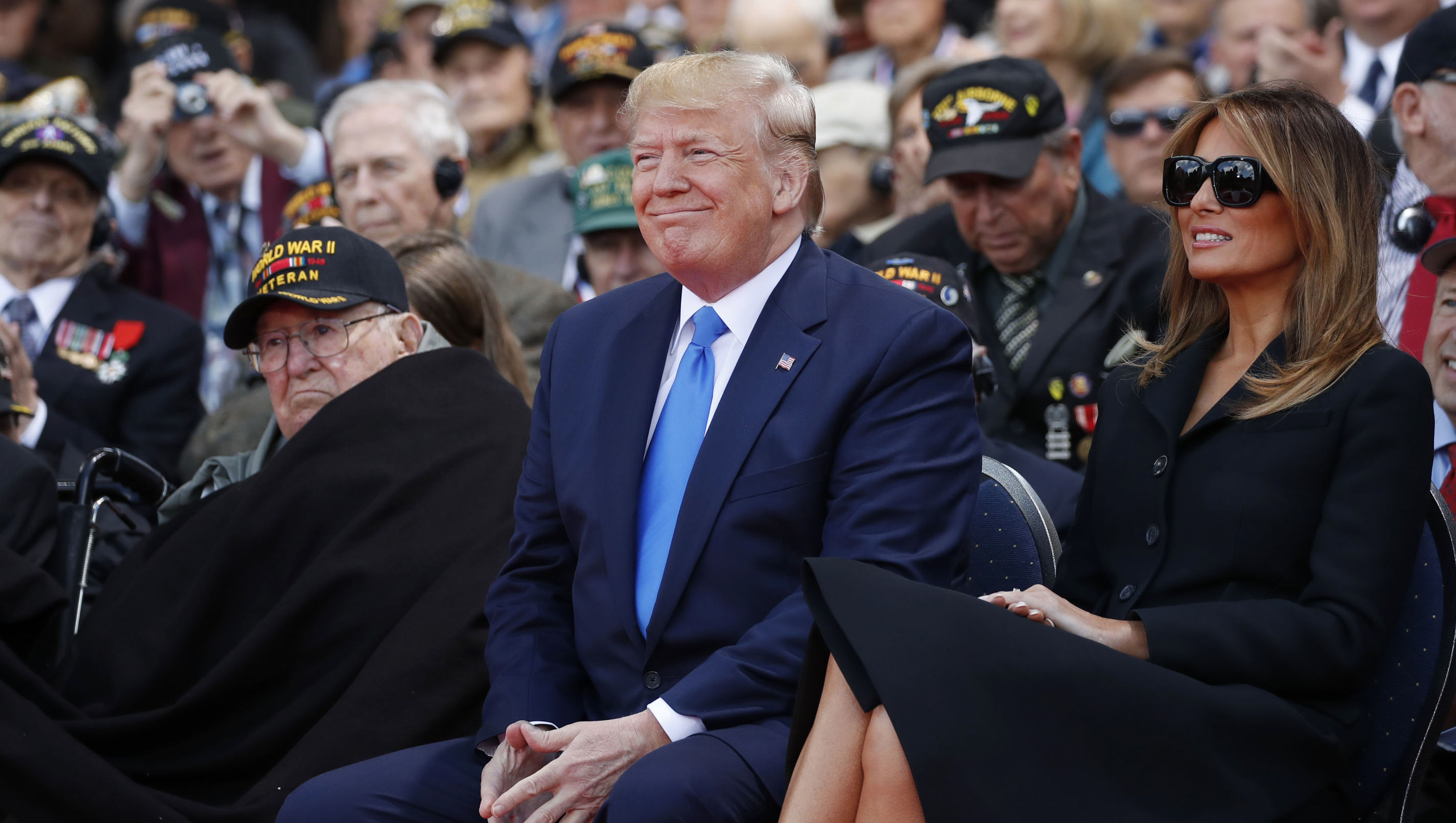 President Donald Trump and first lady Melania Trump, participate in a ceremony to commemorate the 75th anniversary of D-Day at the American Normandy cemetery, Thursday, June 6, 2019, in Colleville-sur-Mer, Normandy, France.