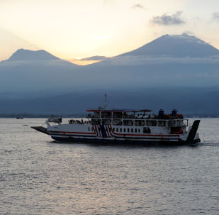 A ferry carries passengers headed for Java island from the port of Gilimanuk in Jembrana on the majority Hindu island of Bali on July 2, 2016.