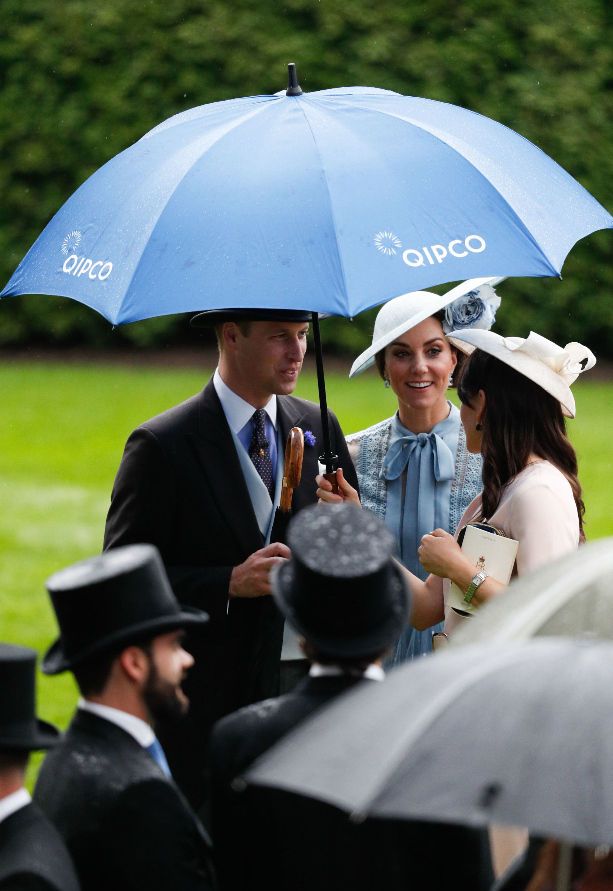 Britain's Prince William, Duke of Cambridge, (L) and Britain's Catherine, Duchess of Cambridge, (C) attend on day one of the Royal Ascot horse racing meet, in Ascot, west of London, on June 18, 2019