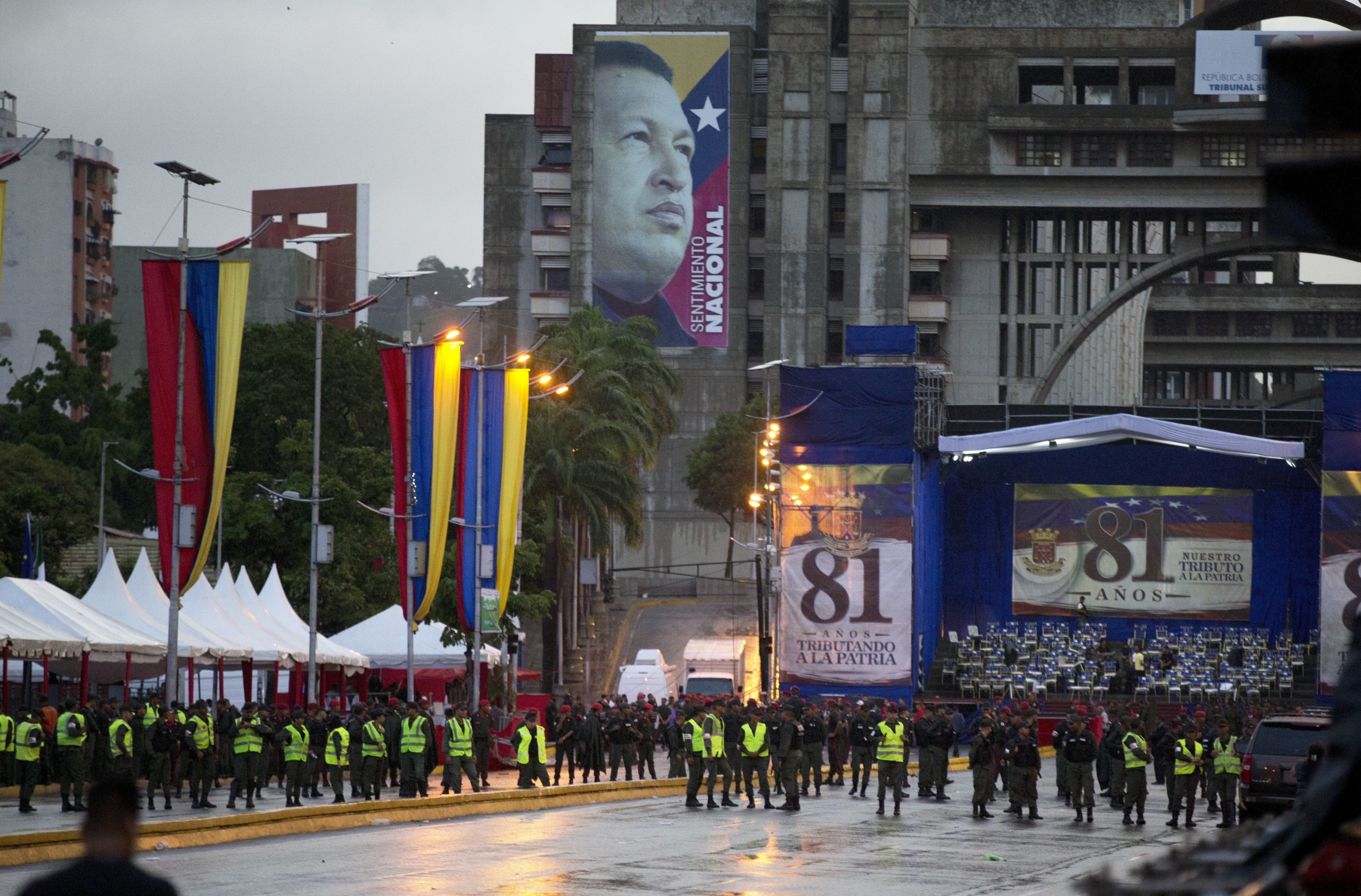 Venezuela's Bolivarian National guards officers occupy the Bolivar Avenue where the government said that a drone armed with explosives detonated near Venezuelan President Nicolas Maduro in Caracas, Venezuela, Saturday, Aug. 4, 2018