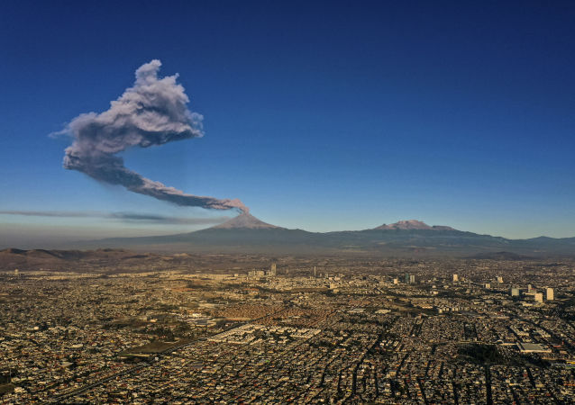 The Popocatepetl Volcano spews ash and smoke as seen from Puebla, central Mexico, on March 28, 2019