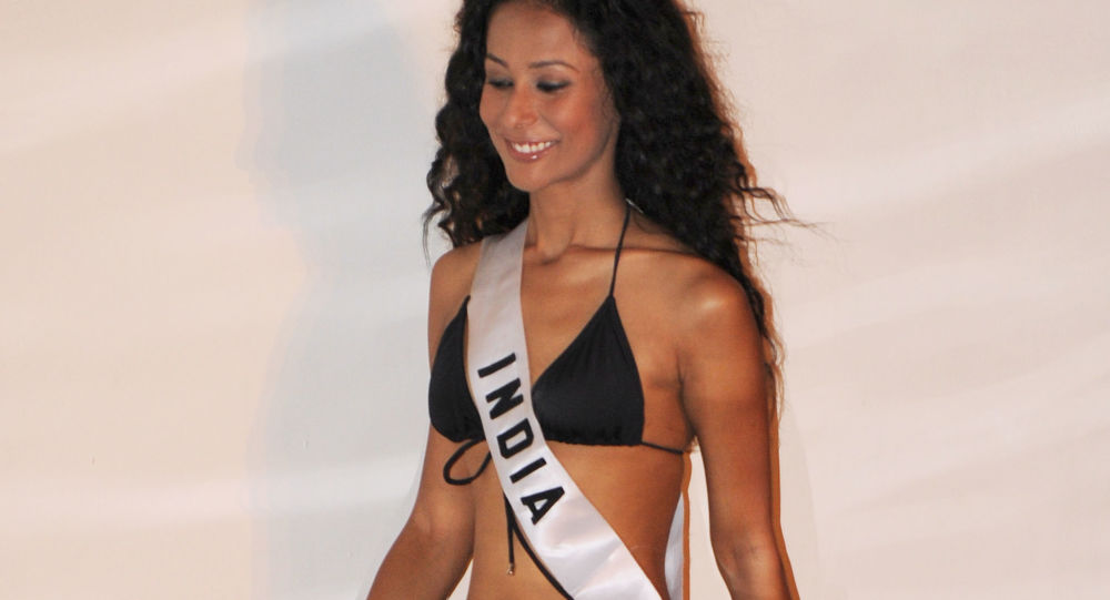 Miss India Ushoshi Sengupta poses for photographers during the Miss Universe 2010 Contestant Swimsuit Event at the Mandalay Bay Hotel in Las Vegas on August 21, 2010