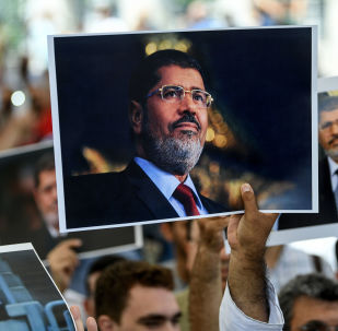 PPeople hold pictures of Egyptian President Mohamed Morsi during a funeral ceremony on 18 June 2019 at Fatih mosque in Istanbul