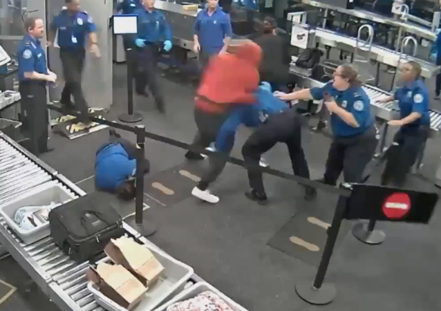 Newly released surveillance footage shows 19-year-old Tyrese Garner tackling several TSA agents at Arizona's Phoenix Sky Harbor International Airport.