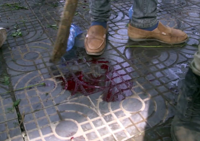 In this image made from video, blood is seen on the ground after an explosion at a rally for Ethiopia's new Prime Minister, in Addis Ababa, Saturday, June 23, 2018.