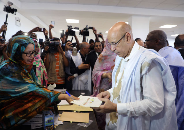 Ruling party presidential candidate and former Defense Minister Mohamed Ould El Ghazouani casts his ballot in Nouakchott, Mauritania