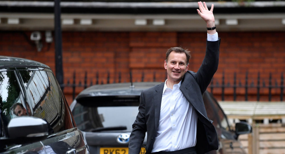 Conservative Party leadership candidate Jeremy Hunt waves as he leaves his home in London, Britain, June 26, 2019