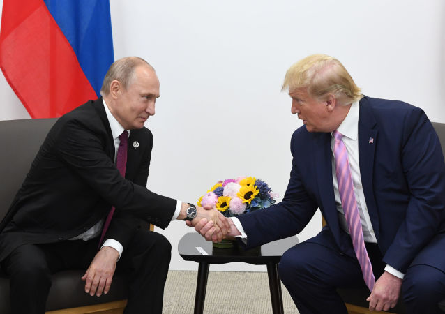 Russian President Vladimir Putin and U.S. President Donald Trump shake hands during a bilateral meeting at the at the Group of 20 (G20) leaders summit in Osaka, Japan.