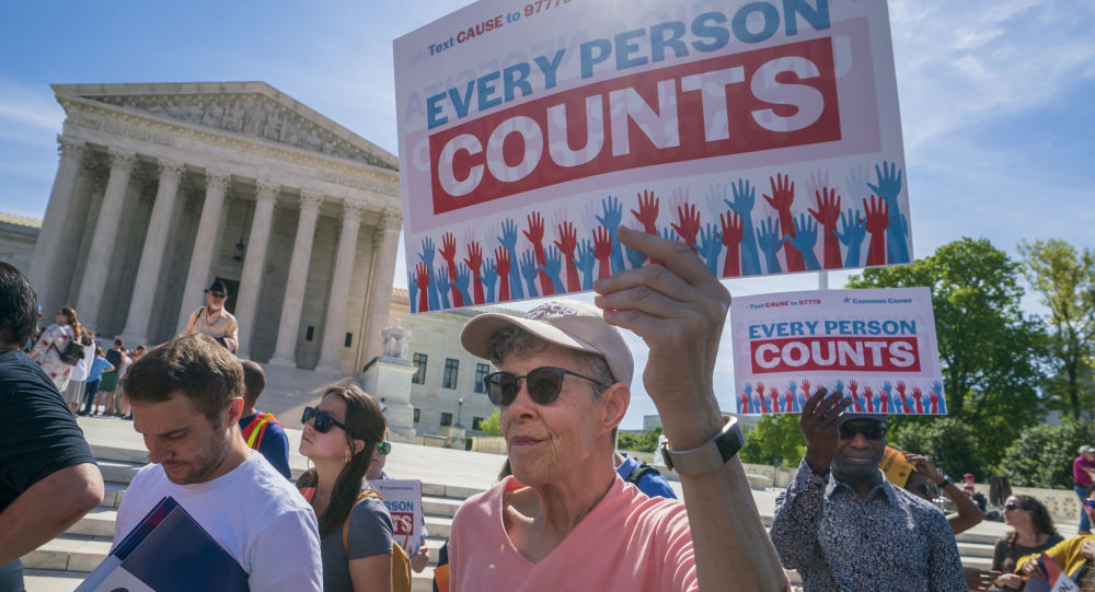 Immigration activists rally outside the Supreme Court as the justices hear arguments over the Trump administration's plan to ask about citizenship