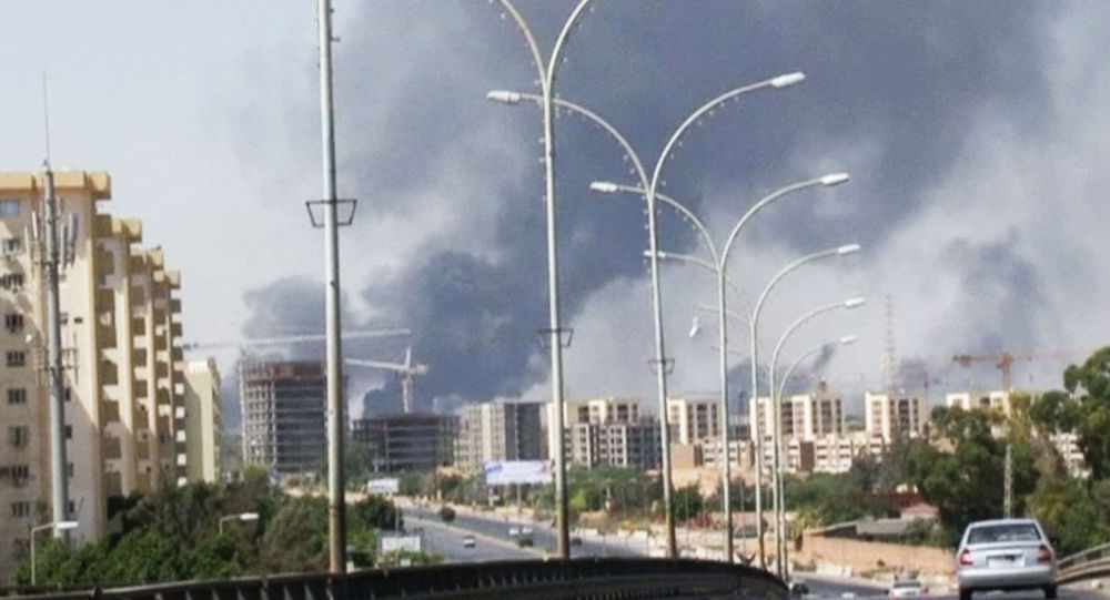 July 13, 2014 file image made from video by The Associated Press, smoke rises from the direction of Tripoli airport in Tripoli, Libya.
