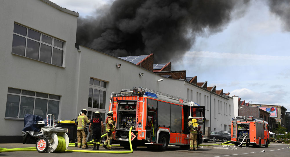 Smoke rises over the the burning Dong Xuan Center, an Asian shopping centre in Berlin, Germany, July 4, 2019