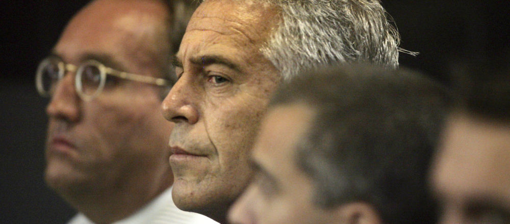 U.S. financier Jeffrey Epstein (C) appears in court where he pleaded guilty to two prostitution charges in West Palm Beach, Florida, U.S. July 30, 2008
