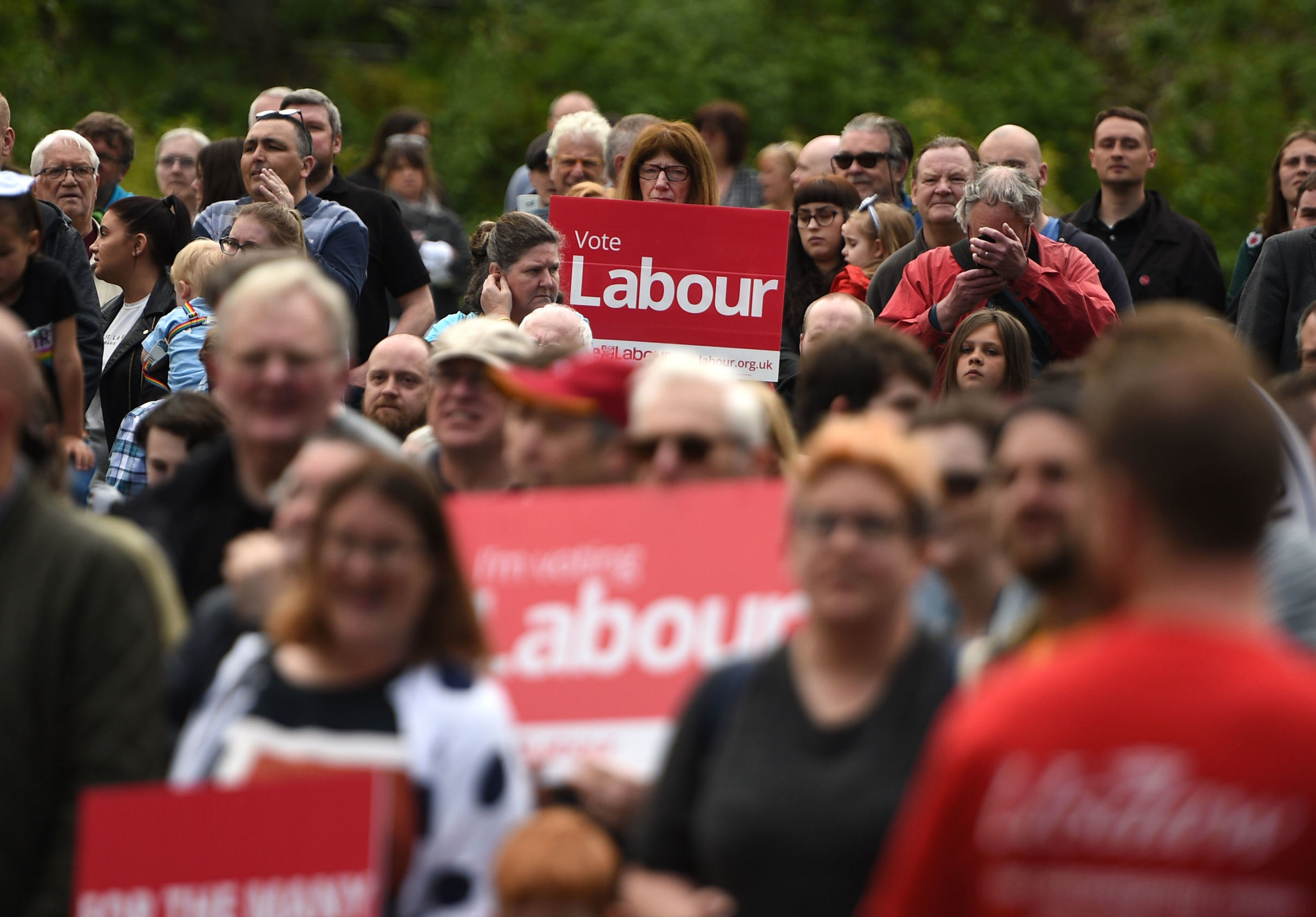 Supporters gather as Britain's opposition Labour party leader Jeremy Corbyn attends a European Parliament election campaign rally in Bootle, north England on May 18, 2019.