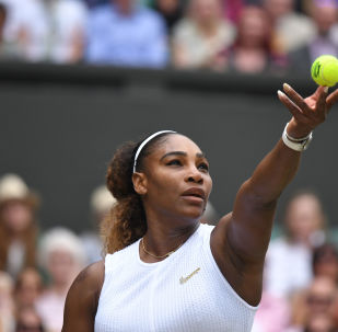 US player Serena Williams serves against Romania's Simona Halep during their women's singles final on day twelve of the 2019 Wimbledon Championships