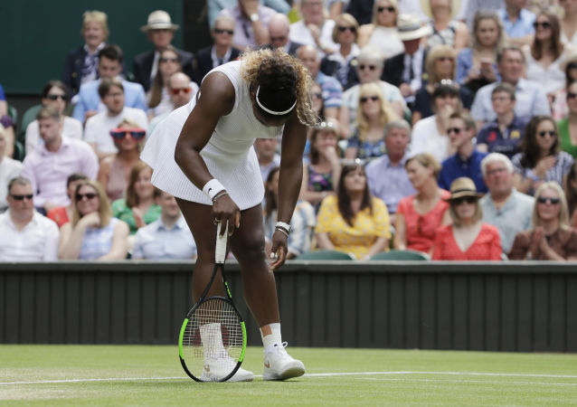 United States' Serena Williams is dejected after losing a point during the women's singles final match against Romania's Simona Halep on day twelve of the Wimbledon Tennis Championships in London, Saturday, July 13, 2019.