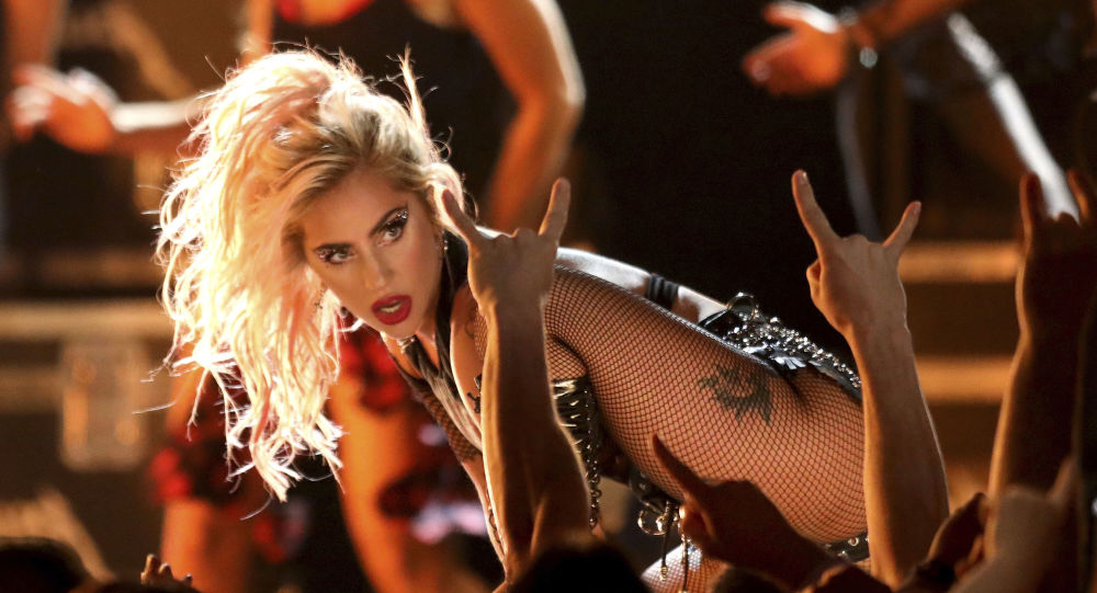 In this Feb. 12, 2017 file photo, Lady Gaga performs Moth Into Flame at the 59th annual Grammy Awards in Los Angeles. Gaga postponed her concert in Montreal scheduled for Sept. 4, 2017, citing laryngitis and a respiratory infection