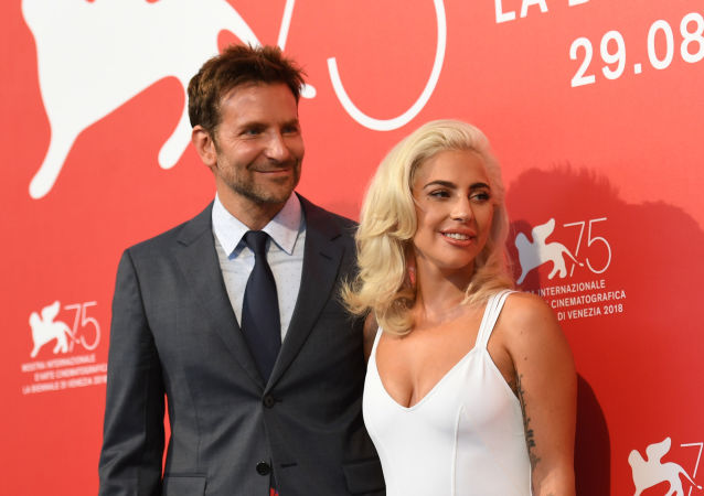 Actor Bradley Cooper and singer Lady Gaga during a photo call for A Star is Born at the 75th Venice Film Festival