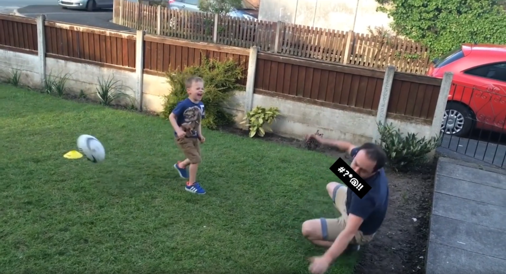 Man cussing after being hit in the mouth by his child's soccer ball