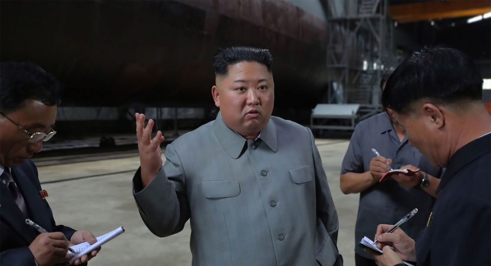 This undated picture released from North Korea's official Korean Central News Agency (KCNA) on July 23, 2019 shows North Korean leader Kim Jong Un (C) inspecting a newly built submarine at an undisclosed location.
