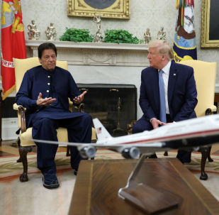 Pakistan's Prime Minister Imran Khan speaks while meeting with U.S. President Donald Trump in the Oval Office at the White House in Washington, U.S., July 22, 2019