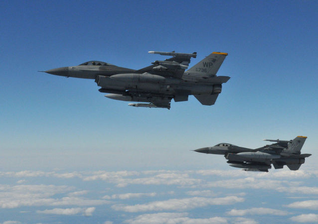 Two F-16 Fighting Falcons pilots with the 8th Fighter Wing's 80th Fighter Squadron, Kunsan Air Base, Republic of Korea