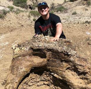 Harrison Duran, a fifth-year biology student, discovered a Triceratops skull during a paleontology dig in North Dakota