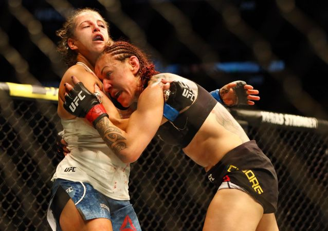 Jul 27, 2019; Edmonton, Alberta, Canada; Cris Cyborg (red gloves) and Felicia Spencer (blue gloves) during UFC 240 at Rogers Place. Mandatory Credit: Sergei Belski-USA TODAY Sports